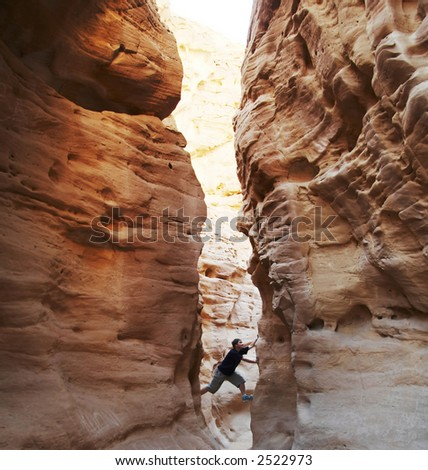 girl climbing in the canyon walls - stock photo