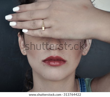 girl closed her eyes with her hands - stock photo