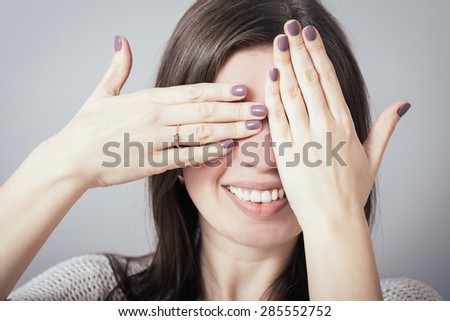 girl closes eyes hands - stock photo