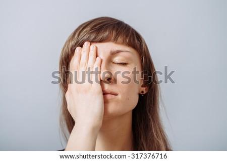 girl closes one eye - stock photo