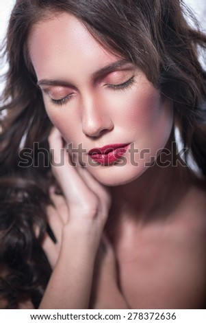 Girl Closing eyes with sensuality gently massaging his neck. isolated on white background - stock photo