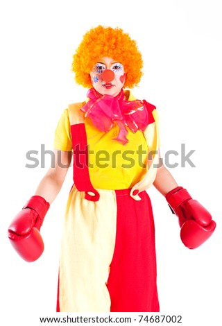 girl clown colored suit and boxing gloves - stock photo