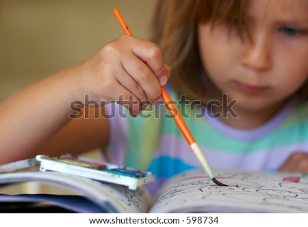 Girl coloring a book