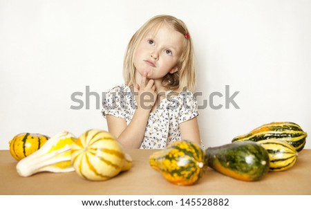 Girl Counting Pumpkins - stock photo
