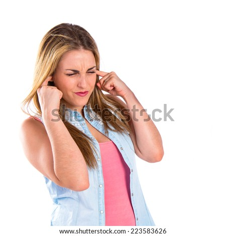 Girl covering her ears over white background - stock photo