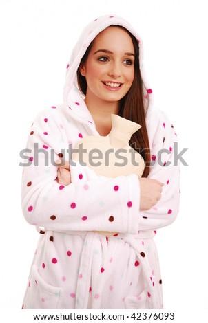 Girl cuddling hot water bottle on white background - stock photo