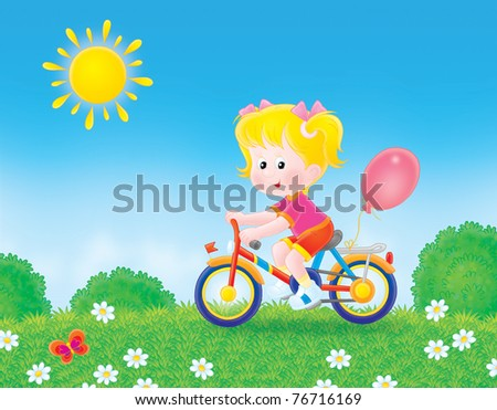 girl cycling through a field in summer day - stock photo