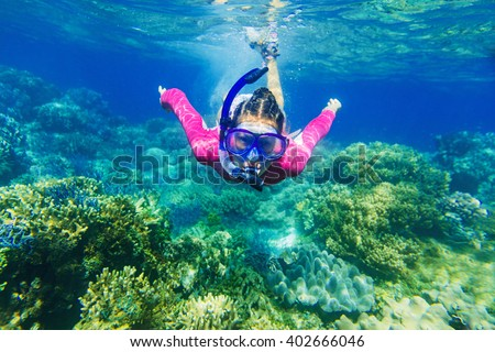 Girl dives in a tropical sea - stock photo