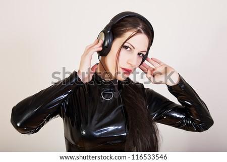 Girl DJ with headphones on her head - stock photo