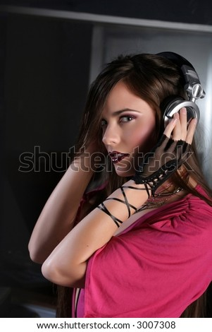 Girl DJ with headphones wearing a pink shirt