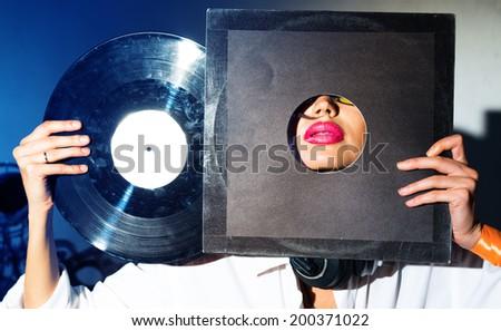 Girl DJ with vinyl records - stock photo