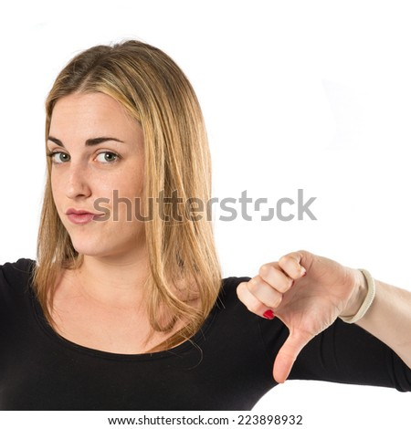 Girl doing a bad signal over white background