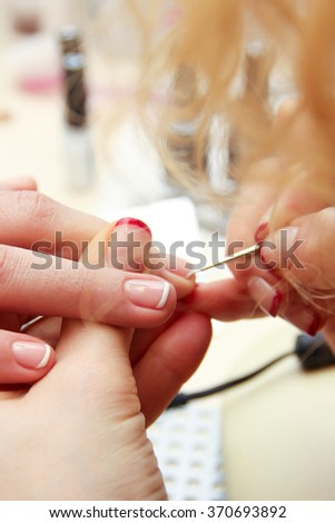 Girl doing a French manicure