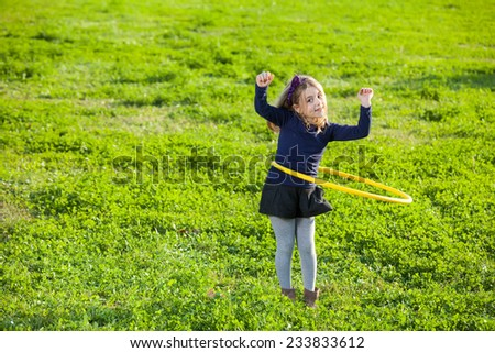 girl doing exercise with plastic circle - stock photo