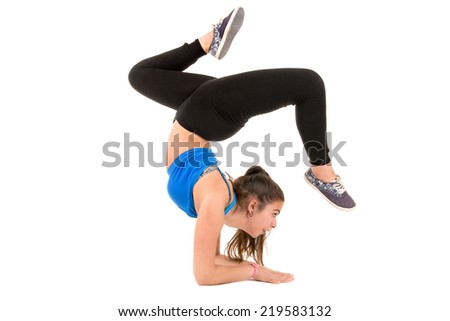 Girl doing exercises isolated in white