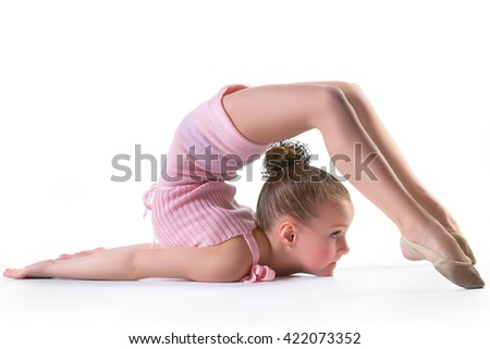 Girl doing gymnastic exercises or exercising on white background