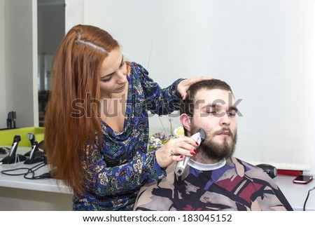 girl doing hairstyle at the guy