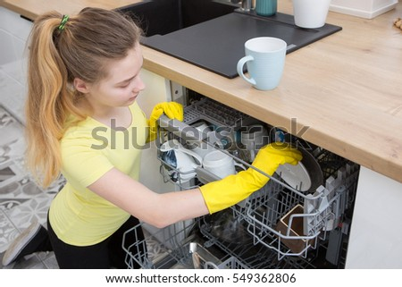 girl doing housework in the kitchen