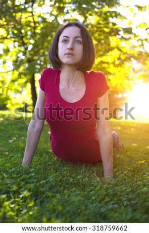 Girl doing sports exercise in the early morning. - stock photo