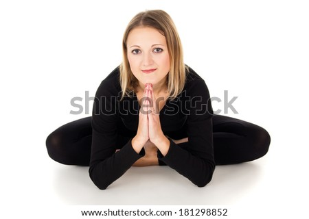 Girl doing stretching exercise and relaxation on the floor - stock photo