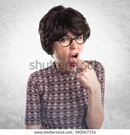 Girl doing vomiting gesture - stock photo