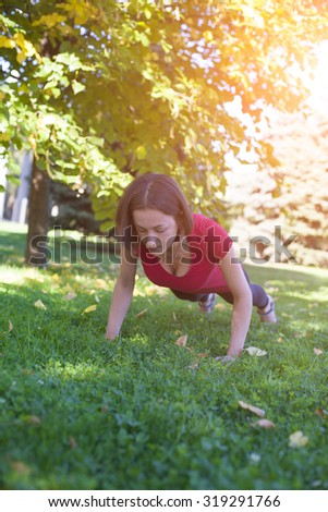 Girl doing yoga in the early morning. - stock photo