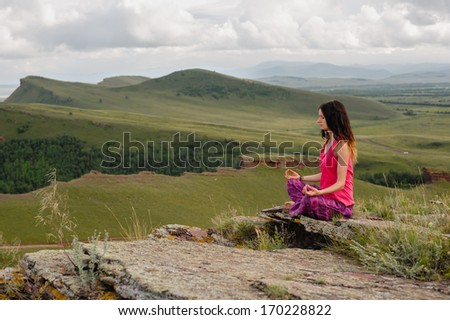 girl doing yoga in the mountains - stock photo