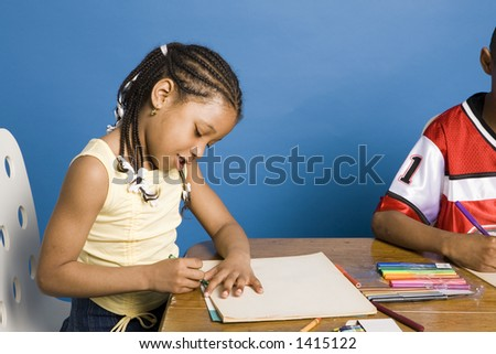 Girl drawing a picture - stock photo