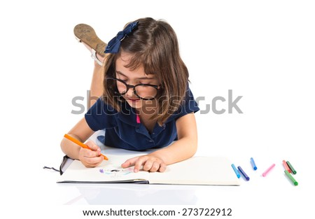 Girl drawing on notebook