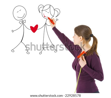 girl drawing Valentine couple holding hands - stock photo