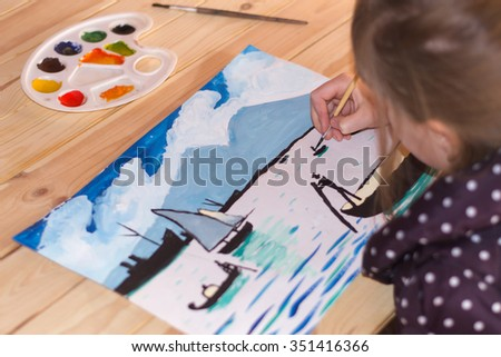 Girl draws fishermen in a boat on the water gouache on paper in warm colors - stock photo