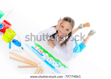 Girl draws on the album. Isolated on white background - stock photo