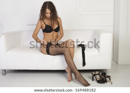 Girl dress stockings sitting on a white couch
