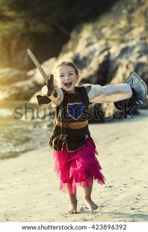 Girl dressed as a knight - stock photo