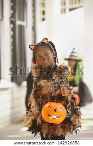 Girl dressed as cat for Halloween - stock photo
