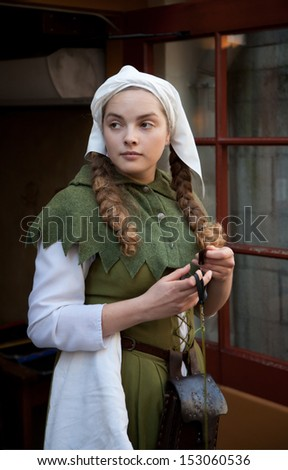 Girl dressed in medieval dress - stock photo