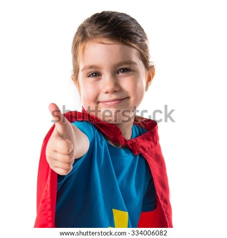 Girl dressed like superhero with thumb up  - stock photo