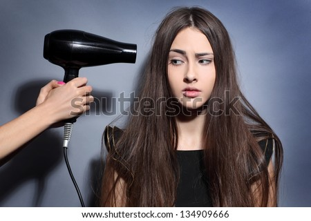 girl dries long hair hairdryer - stock photo