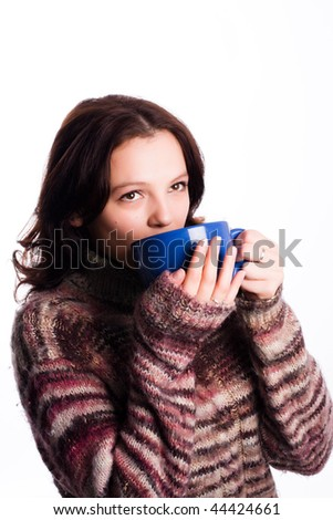 girl drinking from a blue mug