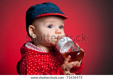 Girl drinking juice from a bottle - stock photo