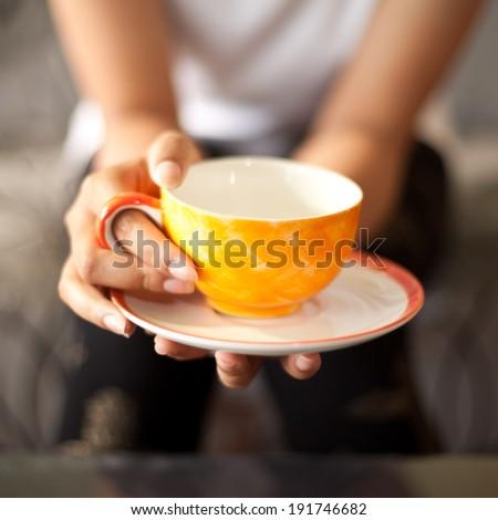 Girl Drinking Tea or Coffee in Cafe - stock photo