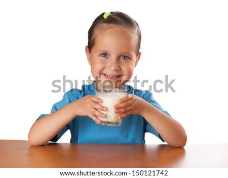 Girl drinks milk, isolated on white. - stock photo