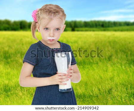 girl drinks milk joke is stained with milk mouth. - stock photo
