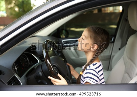 Girl driving parent car