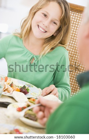 girl eating christmas meal - stock photo