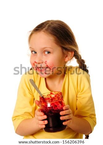 Girl eating homemade jam - stock photo