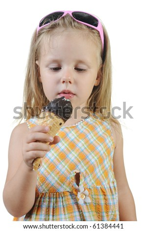 girl eating ice cream. Isolated on a white