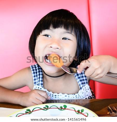 Girl eating in the restaurant - stock photo