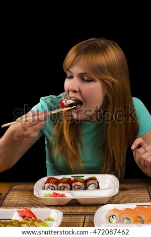 girl eating rolls at the table