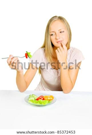 girl eating salad with gusto - stock photo
